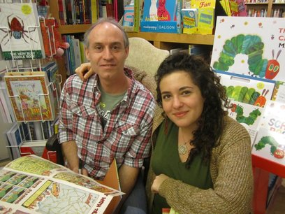 Author Nadja Spiegelman and Illustrator Trade Loeffler pose for a photos surrounded by shelves full of children's books